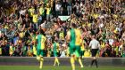 Norwich fans celebrate the second goal scored by Wes Hoolahan during their Barclays Premier League match against Bournemouth at Carrow Road. Photograph: Christopher Lee/Getty Images