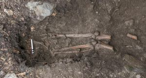The man's lower leg bones in his grave. Photograph: Thorsten Kahlert