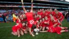 Head over heels: Cork celebrate with the O'Duffy Cup following their win over Galway at Croke Park. Photograph: Ryan Byrne/Inpho