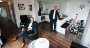 "Barry Alder and Tommy Forbes in a Modular Homes Ireland dwelling at the ""cellular modular housing"" exhibition. Photograph: Nick Bradshaw/The Irish Times"