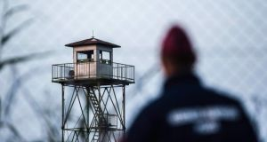 A police officer watches the Serbian side of the border between Hungary and Serbia. Photograph: Sandor Ujvari/EPA