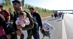Syrian refugees walk along the Istanbul-Edirne highway in an attempt to cross the Turkish-Greek border in Edirne, a city in the west of Turkey. Photograph: Cem Turkel/EPA