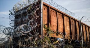 Razor wire is installed on a train wagon used to close the border between Hungary and Serbia near Roszke, 180 kms southeast from Budapest, Hungary. Photograph: Balazs Mohai/EPA