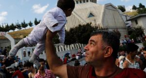Syrian Kurd Salah ad-Din lifts his 7-month-old daughter Hiro Belo as they wait at the main bus station in Istanbul, Turkey, September 15th.  Photograph:  REUTERS/Murad Sezer