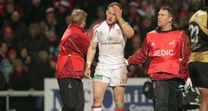 Ulster's Craig Gilroy leaves the field with concussion during  a Heineken Cup match: the graduated return-to-play protocol enabled a team's medical staff to declare a player fit to return to duty after six days. Photograph: Morgan Treacy/Inpho