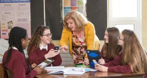 Principal Treasa Leahy with third-year pupils at Mercy Secondary School, Inchicore, Dublin,  with their mobile devices, used for digital learning in schools. Photograph: Dave Meehan