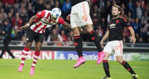 PSV Eindhoven's Luciano Narsingh heads home the winning goal    in the  Champions League match against Manchester United at the Philips Stadion. Olaf Kraak/EPA
