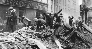 Poor children of Dublin collecting firewood from the ruined buildings damaged in the Easter Rising. Photograph: Getty Images