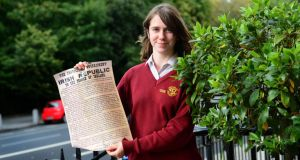 Sophie Bannon, a student at Loreto College, St Stephen's Green, Dublin, with the 1916 proclamation. Photograph: Dara Mac Dónaill