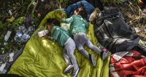 Children of refugees sleep at the Hungarian border with Serbia near the town of Horgos. Photograph: Armend Nimani/AFP/Getty Images
