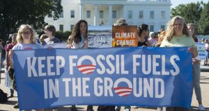 Activists at the White House protest over the Obama administration's plans to allow new fossil fuel drilling. Photograph: Saul Loeb/AFP/Getty Images