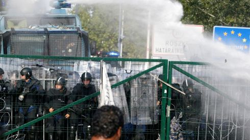 Hungarian police use water canon at the Hurgos border crossing with Serbia. Photograph: Darko Vojinovic/AP