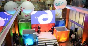Richard Moat , CEO eir, on stage with staff looking on during the launch of the brand eir , formerly known as eircom, in the company's offices at Heuston South Quarter, Dublin. Photograph: Eric Luke / The Irish Times