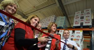 Valerie Cummins and Michael McDonagh from Crosscare with Tánaiste  Joan Burton. Photograph: Alan Betson