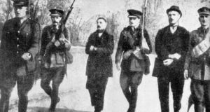 Thomas Kent (left) and William Kent being marched by British soldiers across Fermoy Bridge in May 1916