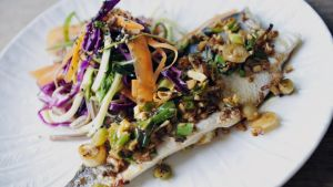 Domini Kemp Baked Seabass, ginger and spring onion with Soba noodle salad. Photograph: Aidan Crawley