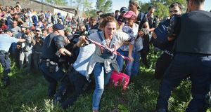 People force their way through police lines at Tovarnik station, Croatia,  to board a train to Zagreb on on Thursday. Migrants are now diverting to Croatia from Serbia after Hungary closed its border with Serbia, with the majority of them trying to reach Germany. Photograph:Jeff J Mitchell/Getty Images