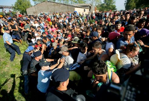 Police try to prevent a stampede at Tovarnik, Croatia, on Thursday. Photograph: Antonio Bronic/Reuters