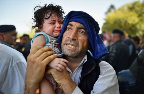 A man holds his crying child  at Tovarnik station, Croatia. Photograph:  Jeff J Mitchell/Getty Images