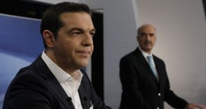 Former Greek prime minister and Syriza leader Alexis Tsipras stands next to the leader of the main Greek conservative opposition 'New Democracy' party, Evangelos Meimarakis, prior to a TV debate. Photograph: Yannis Kolesidis/EPA