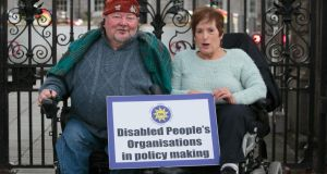 Disability protesters Martin Naughton from Baldoyle and Ann Richards from Knocklyon at a protest to draw attention to inequalities and abuses experienced by people with disabilities and their families due to funding shortfalls and cuts at Leinster House on Thursday. Photograph: Gareth Chaney Collins