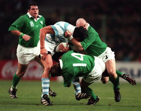 Keith Wood and Justin Bishop of Ireland tackle Ignacio Fernandez Lobbe. Photograph: Billy Stickland/Inpho.