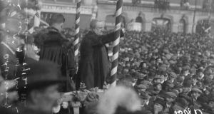 Thronged: John Redmond at the Parnell monumnet on O'Connell Street in 1912. Photograph courtesy of the National Library of Ireland