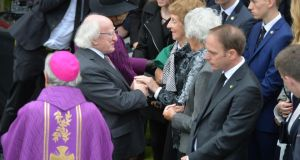 President Michael D Higgins speaking with Thomas Kent's nieces Kathleen Kent and Prudence Riordan and his grandnephew Michael Riordan, after Kent's State funeral. Photograph: Alan Betson/The Irish Times