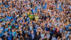 Kerry-born teachers Denise Kearney and Aine O'Connor lost in a sea of blue Dublin fans at Scoil Bhríde  in Blanchardstown prior. Photograph: Brenda Fitzsimons/The Irish Times