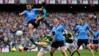 Kerry's Colm Cooper tries to shoot despite the attentions of  James McCarthy and Philly McMahon of Dublin  during the All-Ireland SFC Final at Croke Park. Photograph: Ryan Byrne/Inpho