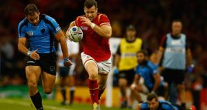 Gareth Davies of Wales breaks for the try line during the Rugby World Cup Pool A match against Uruguay at Millennium Stadium  in Cardiff. Photograph: Laurence Griffiths/Getty Images