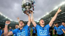 Dublin's Bernard Brogan and Paul Flynn celebrate with the Sam Maguire trophy. Photograph: James Crombie/Inpho