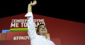 Greek prime minister-elect and leader of leftist Syriza party Alexis Tsipras waves to supporters after winning the general election in Athens. Photograph: Michalis Karagiannis/Reuters