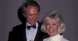 Clint Eastwood and  Doris Day at the Golden Globe Awards in 1989: They are neighbours in Carmel Valley and Eastwood reportedly gave Day  a script which she loved and is set to have her first film role in almost half a century. Photograph: Ron Galella, Ltd/WireImage