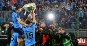 Alan Brogan, Bernard Brogan and Kevin McManamon lift the Sam Maguire in front of Hll 16.
