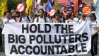 Philippine environmental activists march during a protest at the Human Rights Commission office in Manila on September 22nd, 2015. The activists are calling for an investigation into the top 50 investor-owned fossil fuel companies over climate change impacts upon people and their livelihoods. Photograph: Ted Aljibe/AFP/Getty Images