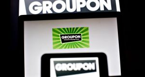 Groupon plans to cut about 1,100 jobs globally, as part of a reorganisation of its international operations. (Photograph: Daniel Acker/Bloomberg)