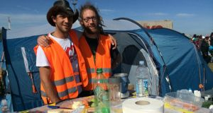 James and Fabian from Zurich, Switzerland, making soup and smoothies for migrants. Photograph: Daniel McLaughlin