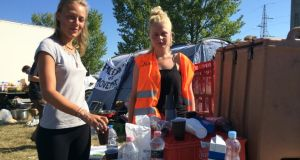 German students Joana and Louisa  running a refreshment point for migrants. Photograph: Daniel McLaughlin