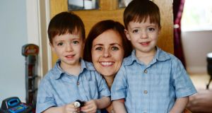 Michelle Corrigan, at home in Swords, Co Dublin, with her three-year-old twins, Eric and Sean, whose lives were saved by the use of ground- breaking surgery at the Rotunda hospital in Dublin. Photograph: Bryan O'Brien