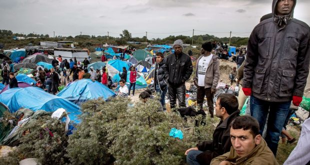 People at a site in Calais, France, dubbed the New Jungle, where some 3,000  have set up camp, September 21st, 2015. Most of them wish to reach  England. Photograph: Philippe Huguen/AFP/Getty Images