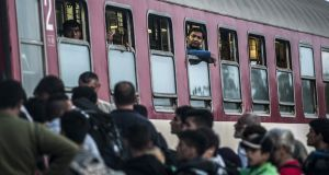Refugees and migrants board a train heading to Serbia near the Macedonian-Greek border on Thursday. Photograph: Getty Images