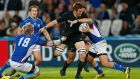Richie McCaw is tackled during New Zealand's unconvincing 58-14 win over Namibia at the Olympic Stadium