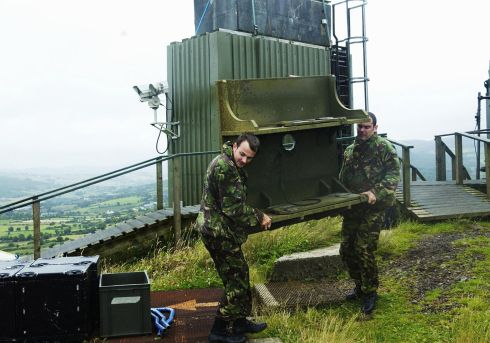 01/08/2005:  A British army handout photograph of a watchtower being dismantled by soldiers in Northern Ireland - (exact location unknown) Photograph:  MoD/PA