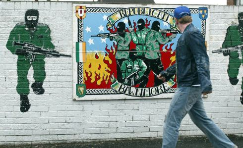 26/09/2005: A man walks past a Republican mural in North Belfast after it emerged the IRA destroyed its weapons. Photograph: Paul Faith/PA