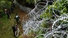 Hungarian soldiers build a temporary  razor-wire fence  at the border between Hungary and Croatia. Photograph: Gyorgy Varga/EPA