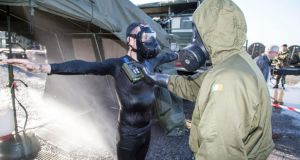 Medics with the International Committee of the Red Cross take part in training in surviving the effects of a chemical, biological, radiological or nuclear.