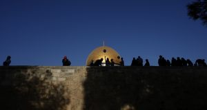 Palestinians walk near the Dome of Rock mosque inside the al-Aqsa Mosque compound, Islam's third holiest site. Photograph: Getty