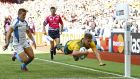 Drew Mitchell scored two of Australia's 11 tries in their 63-3 rout of Uruguay at Villa Park. Photograph: Reuters