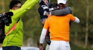Thongchai celebrates holing the winning putt on the 18th hole with his coach during the final round of the Porsche European Open at Golf Resort Bad  Griesbach in Passau, Germany. Photo: Adam Pretty/Getty Images